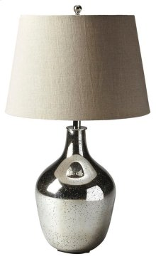 This elegant table lamp will brilliantly light any space. Featuring a mercury antique nickel, it is hand crafted from glass and aluminum with an iron harp and linen shade.