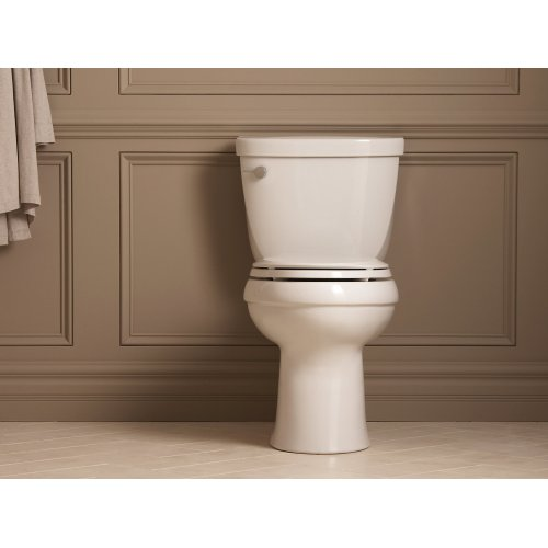 Almond Comfort Height Two-piece Elongated 1.28 Gpf Toilet With Aquapiston Flushing Technology and Left-hand Trip Lever, Seat Not Included