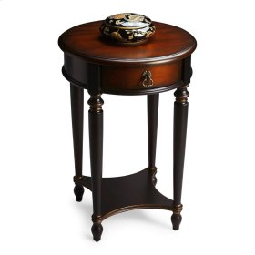 Elegance and versatility make this table a great addition to virtually any space. Hand painted in black and crafted from poplar hardwood solids and wood products, it features a rich, contrasting, hand rubbed cherry veneer top and drawer front with a light