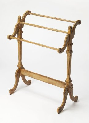 This distinctive traditional quilt rack will stylishly display blankets, quilts or throws. Crafted from hardwood solids, it features three horizontal rails with carved supports in a Driftwood finish.
