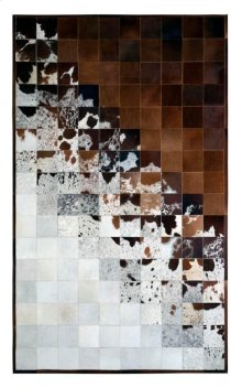 With a splash of monochromatic color or grays and browns, this hair on hide leather rug features a gradation of color from gray to brown, with splashes and speckles each, merging in a pools of solid color. Variations in shades and pile direction are a com