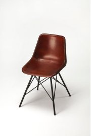 Mid-century modern with a contemporary twist: this go-everywhere molded chair form gets an upgrade with a stitched leather cover and sturdy black iron frame. Think home office, dining room or dorm! Product Image