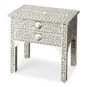 Grey is the newest neutral, married to handcrafted bone inlay in an eye catching vine pattern to create the perfect lamp table or bedstand. The two drawers have delicately carved bone pulls that mirror the shimmering pearlesque detail.