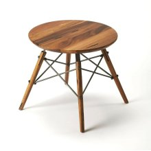This Mid-century modern-inspired bunching table is sure to attract attention in any living or work space. Anchoring the table's beautifully grained solid mahogany top are four solid mahogany splayed peg legs that are architecturally conjoined by forged ir