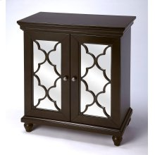 Versatility that is making a style statement within this mirrored chest. The beautifully cut fretwork adorned over the mirror paneled doors simply capture the eye. The beauty of the rich Birch veneers are captured by the destinctive color finish to add a