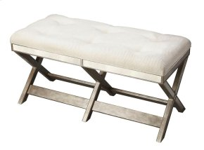 This striking bench is a glamorous addition to virtually any space with antique-finished mirror inlays. Hand crafted from hardwood solids and wood products, its pewter finish is refreshingly modern with an ivory, button-tufted cotton cushion.