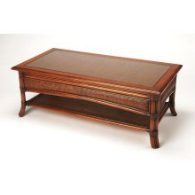 Introduce the ambiance of an island retreat into your living room or office with this rectangular coffee table. With a rattan pole frame and woven rattan panels on the top, sides and bottom shelf, it features a rich chestnut finish and glass inset top wit