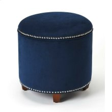 As functional as it is stylish, this round storage ottoman features a cushioned lift-up lid that opens to reveal a spot to stash spare a throw, books, and more. This piece is crafted from Rubberwood solids, padded with foam, and upholstered in Velvet fabr