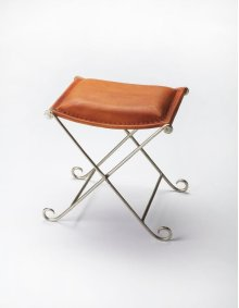 This diminutive stool will stylishly enhance your space. Featuring an industrial chic aesthetic, it is hand crafted from iron, leather.