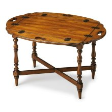 This tray table is as beautiful in a distinctive Vintage Oak finish as it is functional with drop-down leaves that transform its rectangular top into an oval. Its aesthetic extends from the top to the X-stretcher that binds the classic spindle legs. Craft