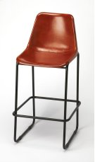 Create a warm ensemble in your eat-in kitchen by pulling several of these stools up to the kitchen island or bar. This modern rustic barstool has rich color in its leather seat. A decortive strip of rivets adorn where the seat meets the back. This seat i Product Image