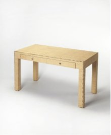 This casual chic writing desk is a modern interpretation of classic Parsons styling. Fully wrapped in raffia, it is lightly textured in a natural cream hue for combination with a broad array of colors and styles. Carefully crafted from gemelina wood solid