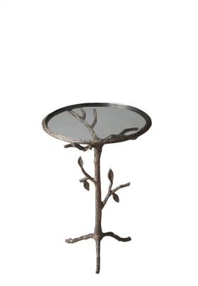 This wonderfully whimsical table, cast in metal, offers meticulously simulated tree trunk, limbs and leaves. Wherever this table is planted, bird songs can't be far away.