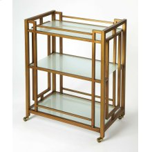 This classic, modern bar cart will transform any space into a sophisticated cocktail bar area. Its all metal frame boasts an inviting antique gold finish with frosted glass shelves. Its matching gold finished casters provide easy mobility from one space t