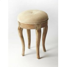 This splendid vanity stool adds formal elegance to any powder or dressing room. Handcrafted from hardwood solids and veneers, it features impeccably carved and tapered legs, ballerina feet, Driftwood finish and a comfortable seat upholstered in cotton hob