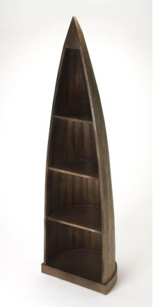 Sure to add character to any space, this whimsical rustic bookcase imitates the silhouette of an old canoe. Crafted from mango wood solids and wood products, it is finished from the front to its curved back in a washed gray finish. Featuring four fixed sh