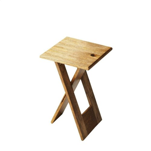 Whimsical, versatile and fun, this table is designed to snuggle into a small spot for a brief visit... or a long stay. Crafted from mango and acacia wood solids.