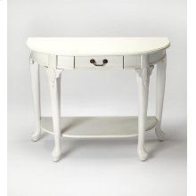 An airy Cottage White finish adds casual sophistication to this traditional console table. Crafted from rubberwood solids, wood products and choice cherry veneers, it features four Queen Anne-inspired legs with a storage drawer and display shelf for stora