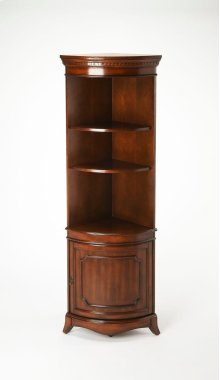This rare corner cabinet will be a cherished addition in any traditional space. Crafted from poplar hardwood solids and wood products, it boasts a rich Plantation Cherry finish on cherry veneers. Perfect for showcasing photos and accessories, it features