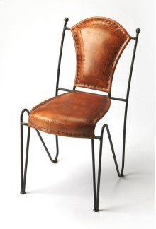With a nimble base providing contrast to an ample, top stitched leather seat and back, this side chair is a stylish addition to the dining room or office. Its fluid form will fit in any modern aesthetic.