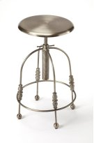 Enhance your kitchen, bar or work space with this industrial barstool. With a round seat that is adjustable in height and can be locked into position by rotating the collar along its post clockwise until tight, the stool's four legs have unique filigree o Product Image
