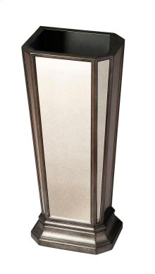 This refined umbrella stand is sure to add a subtle flair to any living space, entryway or office. Crafted from selected solid woods and wood products, it features antique-finished mirrored sides and a pewter finished frame.