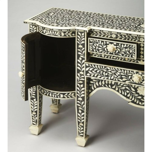 This magnificent Buffet features sophisticated artistry and craftsmansip. The botanic patterns covering the piece are bone inlays formed and applied individually by the hands of a consummate artisan. No two pieces are ever exactly alike, ensuring this Buf
