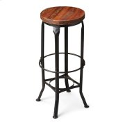 This aged, industrial-look bar stool has a character all its own. Handcrafted from iron and recycled wood solids, it features a distressed finish and a series of circles from base to top and four legs with intriguing bends at top and bottom. Product Image