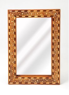 This rectangular wall mirror is an extraordinary feat of craftsmanship. Its wondrous botanical design is painstakingly created inlaying bone ™ within a sheesham wood frame ™ one individual piece at a time. Its hand rubbed finish will elegantly blend with
