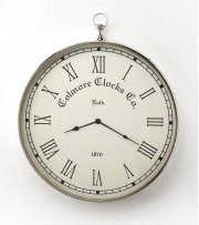 This wall clock is crafted in a round shape that features Roman numerals over a white face, and a sturdy handle. The clock can be placed on any wall and blends with a variety of decor. Makes a great gift. Product Image