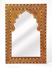 This rectangular wall mirror is an extraordinary feat of craftsmanship. Its wondrous botanical design with a mihrab inset frame is painstakingly created inlaying bone ™ within a merranti wood frame ™ one individual piece at a time. Its hand rubbed finish