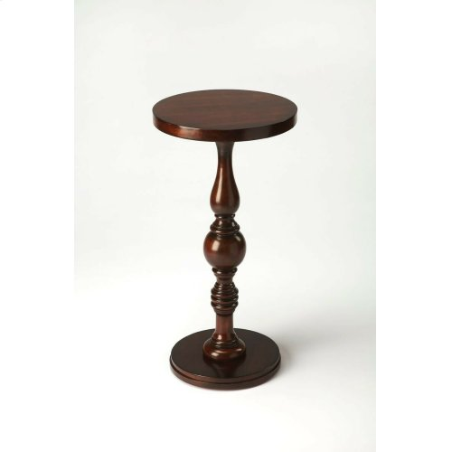Elaborately carved pedestal connects the base with the double-decked tabletop to create a compelling aesthetic for a favorite nook or cranny. Crafted from rubberwood solids and wood products with a cherry veneer top in an Plantation Cherry finish.