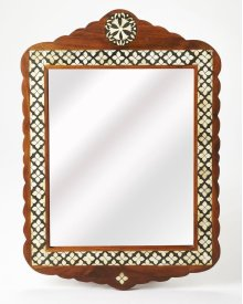 This arched top wall mirror is an extraordinary feat of craftsmanship. Its wondrous Moroccan quatrefoil design is painstakingly created inlaying bone - within a merranti wood frame - one individual piece at a time. Its hand rubbed finish will elegantly bl