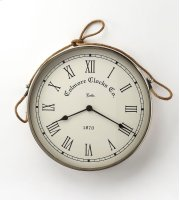 This wall clock is crafted in a round chrome tone frame that features Roman numerals over a white face, and a nautical twine handle. The clock can be placed on any wall and blends with a variety of decor. Makes a great gift. Product Image