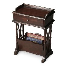 Ample storage and display space in this simply elegant Martini Table that combines function and aesthetics without sacrificing either. Handcrafted from hardwood solids, wood products and cherry veneers in a lustrous Rubbed Black finish.