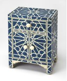 An inspired addition in the living room, bedroom or entryway, this unique accent chest is functional art. Hand-cut and individually formed, bone inlays are arranged in a transfixing geometric pattern within a pool of deep blue. Boasting storage with a con Product Image