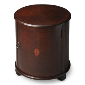 This beauty of this classic drum table is in its simplicity. The matched cherry veneer top and door with a maple and walnut veneer linen-fold inlay framed within a cherry veneer border are complemented by a rich Plantation Cherry finish. Handcrafted from