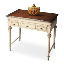 Elegantly tapered and Sheraton-inspired legs establish the antique motif for this lightly distressed desk that is small enough to fit into nooks and crannies but large enough to get the job done. It features a top that lifts open into a large work space,