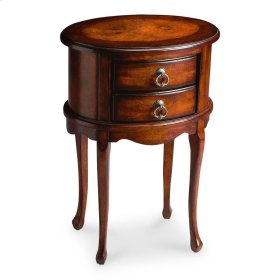 This charming oval side table combines elegant design details with convenient storage. It features a rich, hand rubbed Plantation Cherry finish with light distressing. Hand crafted from select hardwood solids and wood products, it has an attractive ash bu