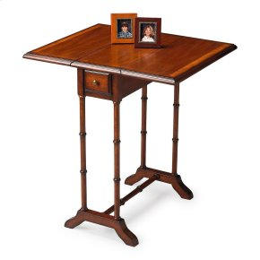 Selected solid woods and choice cherry veneers. Cherry veneer top and leaves with cherry veneer end grain border. Drawer with antique brass finished hardware.