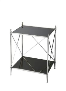 This double-decker end table will be a striking addition to any modern space. Four perfectly proportioned legs meet the floor in delicate ballerina feet. Crafted from iron, glass and aluminum components, its glossy mirrored glass top and bottom shelf are