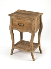 Crafted from mango wood solids and wood products in a natural mango finish, this nightstand is perfect for stowing bedside essentials. This lovely nightstand showcases a single drawer with iron hardware, a scalloped apron and lower display shelf. Product Image