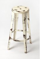 Enhance your kitchen, bar or work space with this rustic industrial barstool. With a round seat, its painted white iron frame is flecked to expose the metal just beneath its surface with hints of oxidation for added character. Product Image