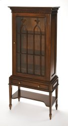 Perfect for putting heirloom serveware and antiqued curios on display, this classic cabinet is a charming addition to any dining room or den. Founded atop four turned legs, its frame is crafted from Mahogany solid wood and finished in a stately brown with Product Image