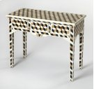 An inspired addition to the living room, bedroom or entryway, this unique console table is functional art. Hand-cut and individually formed, bone inlays are arranged in a transfixing tumble block pattern in hues of brown, black and cream . Boasting storag Product Image