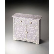 This lavender console chest offers a unique touch to any room. Developed from centuries old artistic traditions, the pastel background showcases the opalescence of hand-carved bone inlay. The two doors and single drawer are complimented with bone pulls