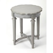Create stylish display in any space with this understated Country French style wood end table, featuring a classic round design with a scalloped edge top and an x-frame stretcher. Let a pair flank a sofa in the living room or let it sit solo in an empty s