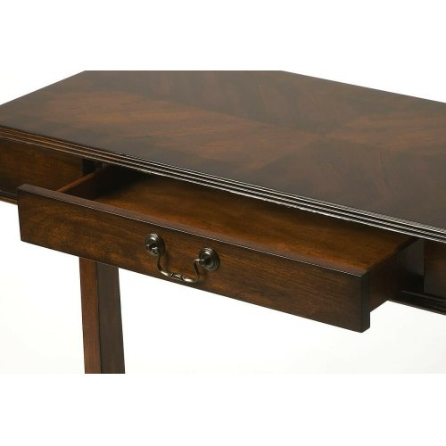 A stretcher with a captivating curve links two thin legs to provide the simply elegant foundation for this classic table with beveled edges and a single, wide drawer with complementary brass-finished pull. Crafted from solid rubber wood, wood products and