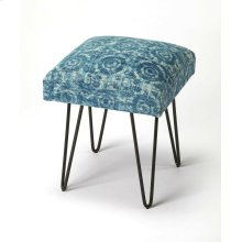 This whimsical modern stool has a subtle psychedelic vibe. Its blue tone-on-tone square cotton upholstered seat is beautifully supported by four iron hairpin legs.