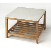 This attractive coffee table is a stunning addition in any rustic modern living room or office. Its slatted base crafted from mango wood solids in an unadulterated natural finish supports a white marble top. Moderately scaled, it is well suited for smalle